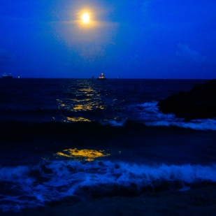 The evening progressed, the moon shining brighter, the sky melting colors and the tide crashing the waves harder.