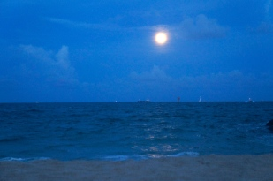 As the clouds dispersed, the full moon could be seen in its entirety.